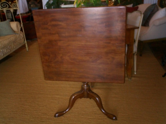 "Antique mahogany tilt-top pedestal table.  Approximately 48"" square."