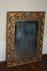 Antique ornate repousse brass framed mirror