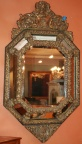 Multi-faceted octagonal mirror with elegant detail and shape