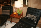 Pair of Ludwig Mies van der Rohe black leather Barcelona chairs with ottomans