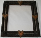 Tramp art frame with hearts