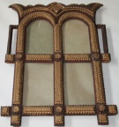Finely carved tramp art four section frame