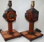 SOLD - Pair of carved tramp art lamps, each with a small drawer
