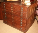 SOLD - Antique circa 1900 oak 11 drawer map / file cabinet with all original hardware and nicely detailed paneled sides.