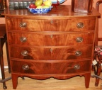 American Federal (1790) mahogany bow front chest of 4 drawers with string inlay details on graceful bracket legs.