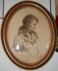 Oval framed drawing of a woman