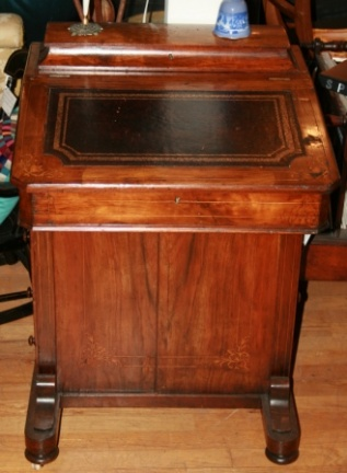 Antique Captain's writing desk with stamped leather writing surface that lifts open.  Four side drawers.  Fine inlaid design.