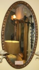 Oval gold framed mirror