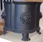 Pair of antique black cast iron jardiniere with lion decor