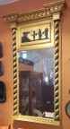 Antique Empire gold framed mirror with black accent