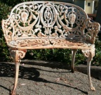 Pair of antique (circa 1880) cast iron garden bench in the Versailles design with neoclassical detailing.
