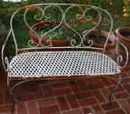 Hand wrought iron bench in the double heart design