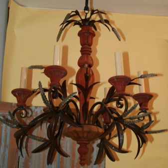 Vintage wood and iron six arm chandelier with decorative wheat design elements.